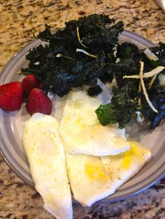 fried eggs, kale chips with onions, strawberries