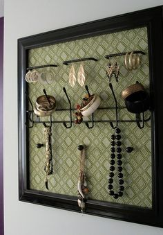 Make your own jewelry holder out of an old frame and doorknobs.