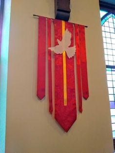 Pentecost banner, ribbons of varying widths, table runner from Dollar Tree, felt cut out doves, made 4 for less than $30, Pentecost decorations. May try to incorporate gold ribbons at Christ,mas, change dove to a star? Church Banners Designs, Alter Decor, Church Fellowship, Faith Crafts, Church Stage, Altar Decorations, Church Flowers, Art Corner, Church Crafts