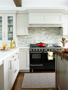 Selecting one backsplash treatment promotes continuity while some tile colors echo elements throughout the kitchen to visually link materials and components! http://www.bhg.com/kitchen/backsplash/kitchen-backsplash-ideas/?socsrc=bhgpin111414separatebutsynchronized&page=9