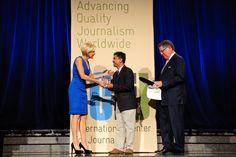 Mika Brzezinski and Knight Foundation President Alberto Ibargüen give Thet Sambath his Knight International Journalism Award. Photo by Alexander Morozov.