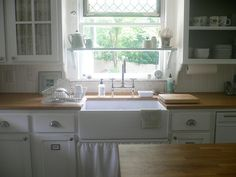vintage: I like the shelf above the sink.