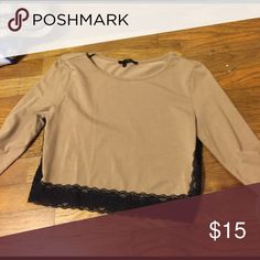 Tan crop top with lace LOVE THIS!! Tan crop top with long sleeves, lace detailing along the bottom and on the sides. So comfortable and flattering on! Great condition 👍🏻 Forever 21 Tops Crop Tops