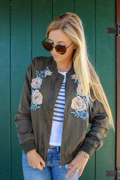 Women's Army Green Bomber Jacket - Shop Nelipot Apparel  Bombers have been a hit already in Women's Fashion and they are making a come back for this Fall! The Floral stitching on this bomber  makes it stand out from the rest!