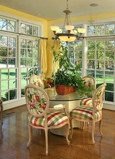 Breakfast room.  I love the openness of it, with the floor to ceiling windows.  Also like the fabric on the chairs