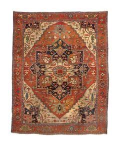HERIZ CARPET  NORTHWEST PERSIA, LATE 19TH CENTURY  Approximately 13 ft. 8 in. x 10 ft. 8 in. (417 cm. x 325 cm.)