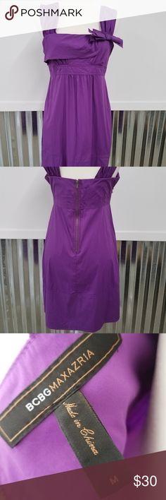 "BCBG Maxazria Purple Dress with Bow BCBG Maxazria Purple Dress with bow. This is knee length and zips up the back. Accent bow. There are adjustable spaghetti straps underneath.   Measurements: 17""W, 28"" L  0001 BCBG Maxazria Dresses Midi"