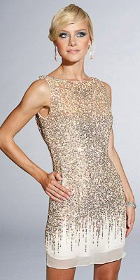 glitter dress. This high cut dress with drizzling sparkle is really elegant. The champagne color is hot!  ~Chloe Monroe