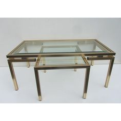 <p>This set of anodized aluminium structure in glossy gold with beveled glass tops signed by the iconic designer Pierre Vandel Paris, 1970 Inside the structure a rim of gold and black Good vintage condition with minimum signes of wear Large table 105 cm x 54 and 43,5 cm high Small table 47 cm x 54 cm and 38,5 cm high</p>