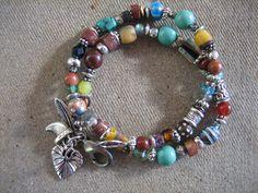 TRIBAL STYLE WRAP bracelet  Boho Chic  two strand African beads bracelet silver charms free ship. $42.00, via Etsy.