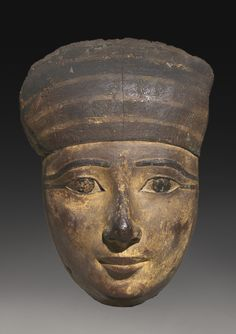 An Egyptian Polychrome Wood Mummy Mask, 22nd/early 25th Dynasty, circa 944-700 B.C.