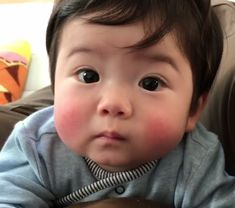 Chubby cheeks dimple chin rosy lips.....