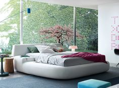 Upholstered fabric double bed with removable cover BIG BED by Poliform design Paola Navone