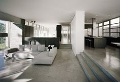 Cool concrete floor.  modern living room by Audrey Matlock Architects