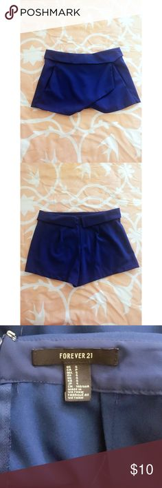 Blue Forever 21 Skort Never been worn but with no tags. Small. I'm between an extra small and a small and this fit a little too big on my waist. I can model upon request! Forever 21 Skirts Mini