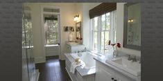 Master bath inspiration - Carrera marble, glass doors, dark floors, white cabs.