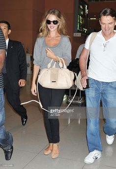 Actress Rosie Huntington-Whiteley arrives at Kansai International Airport to attend the 'Transformers: Dark of the Moon' press conference and stage greeting on July 15, 2011 in Osaka, Japan. The film will open on July 29 in Japan.