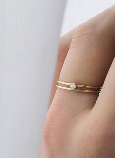 Our round diamond stacking ring is the perfect balance of simplicity and edge. Featuring a .03ct white diamond, bezel-set on a 14k gold band, this ring is easy to wear everyday and fun to stack with o