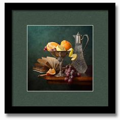 Oranges And Grapes - - Fruit still life with fresh oranges and lemons in metal vase, and pink grapes, old book and tall glass pitcher on wooden table  by Nikolay Panov