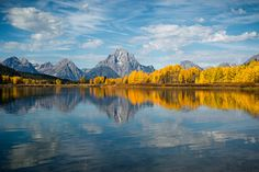 Another image from our roadtrip to the Grand Tetons/Yellowstone last month. This reflection shot was taken from the water level, as you can see we got some pretty nice clouds and full autumn colors...hope you like it!     Thank you for viewing, voting and/or any consrtuctive comments!