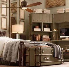 Old luggage at the foot of the bed...LOVE!!