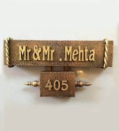 Name plate on the front door of house gives the first impression of any house and makes it look impressive and stylish. Modern name plate design ideas helps in making amazing and stylish looking flats.