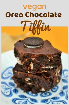 Oreo Chocolate Tiffin. An easy no-bake treat filled with Oreos and raisins and topped with an extra coat of chocolate. Dairy Free and delicious. Add to your lunchbox or enjoy as dessert. #tiffin #chocolatetiffin #traybake #vegan #vegantraybake #vegantiffin #veganchocolate #dessert #vegandessert #vegannobake #vegansnack #snack #oreos #oreocake