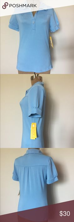NWT Lole Women's Polo Baby Blue Size Large This shirt has it all- style, comfort, wicking fabric, spandex stretch, bacteria treated and UPF 50!  Soft light blue color with feminine touches. New with tags. Size Large. Nylon/spandex. Smoke free home. Lole Tops Blouses