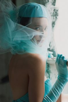 Aqua tulle and lady like gloves make for a charming story!    by this modern romance