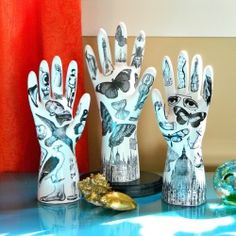 Make funky tattooed plaster hands to display your jewelry using rubber gloves and plaster of Paris.