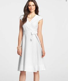 You don't have to be walking down the aisle to be a vision in white.  As the weather continues to get warmer, incorporate more white into your wardrobe, like this eyelet dress from @Ann Taylor.  Add a pair of red Aravon sandals for a fun contrast. (via  www.anntaylor.com)