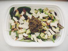 Avocado, mozzarella, walnuts, and pesto on mixed greens. Yummy salad to take on the go!