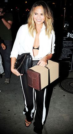 Chrissy Teigen leaving Craig's restaurant in West Hollywood, CA on August 3, 2015, wearing an  Anthony Vaccarello plunging neck draped blouse, a  Chloe Black Medium Faye Bag and  Balmain Two tone high-waisted flared viscose knit pants. #chrissyteigen #style