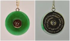 "Jem's Jade Pendant – This lovely pendant is a representation of the one Jem gives to Tessa in Clockwork Prince. Made from bronze, trapped jade donut, featuring the chinese symbol for love pierced in the front and ""When two people are at one in their inmost hearts, they shatter even the strength of iron or of bronze"" stamped in the back. (The Infernal Devices by Cassandra Clare)"