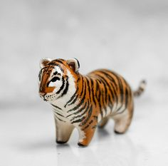Wouldn't this be a cute drawer pull?  Tiger Figurine OOAK Handmade Polymer Clay Animal Totem