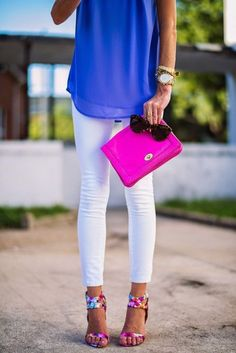 Royal blue blouse & white skinnies. Floral high heel sandals and fuchsia purse clutch. Gorgeous summer outfit.