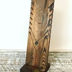 """This beautiful 18"""" tall rustic wood necklace stand is now available on Etsy, Amazon, eBay, and Kaizenwoodworks.com. It is collapsable, reversible, holds up to 8 necklaces, and is made from solid pine wood."""