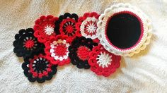 Crocheted set of 8 coasters and holder.  You can find some of my other designs at https://www.etsy.com/uk/shop/Hookintothebeat