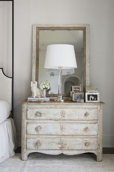 French country farmhouse decor in a bedroom with antique chest near bed. Nest and Cot Interior Design.