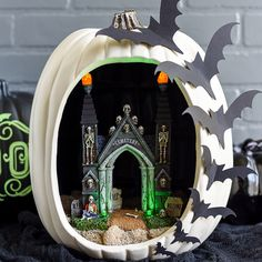 DIY Spooky Pumpkin Diorama: Digging the black and white look this Halloween? Spookify your pumpkin diorama with a toy graveyard gate and then add paper bats around the outside for an extra cool touch. (via A Pumpkin and a Princess) Halloween Diorama, Spooky Halloween, Diy Halloween Party, Fröhliches Halloween, Adornos Halloween, Manualidades Halloween, Halloween Crafts For Toddlers, Diy Halloween Decorations, Holidays Halloween