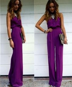 Elegant purple Jumpsuit with statement necklace and taupe clutch