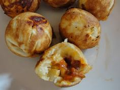 Pizza bites-Crescent rolls, spaghetti sauce and Colby cheese  cooked for 5 minutes in cake pop maker