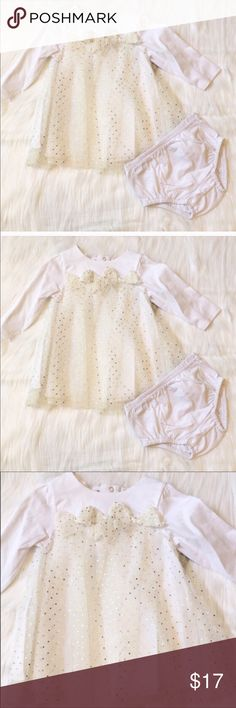Baby Holiday Dress This is a NWT Baby Dress by Absorba. It's a beautiful white with mesh overlay that has shiny gold dots and a bow appliqué. Snap back closure and a matching diaper cover. Lining of dress and diaper cover are 100% cotton. Absorba Dresses Casual