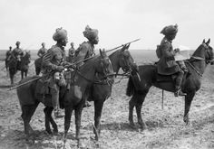 Forward scouts of the 9th Hodson's Horse, an Indian cavalry regiment, pause to consult a map, near Vraignes, April 1917. Photograph:   Brooks, Ernest (Lt)