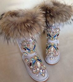 http://www.aliexpress.com/item/Original-Design-Hand-made-Totem-Rhinestone-Snow-Boots-Women-Foxfeather-Mid-calf-Warm-Winter-Booties-Luxurious/32416225067.html