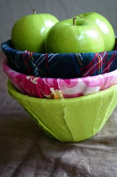 Old lampshades are wrapped in fabric strips make cool bowls