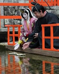 "Prayer for Health with Elegant ""Nagashi-bina"" (Kyoto Shimbun:2009.3.3) A man and woman dressed in heian era robes."