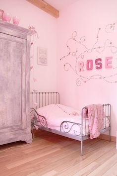 vintage, pink but not toot pink.... I really need this bed for my girl! out of stock for the moment :(