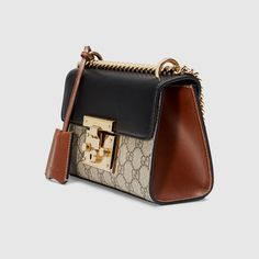 Shop the Padlock small GG shoulder bag by Gucci. A small structured GG Supreme canvas bag with a leather top and our key lock closure. The sliding chain strap can be worn multiple ways, changing between a shoulder and a top handle bag. Burberry Handbags, Prada Handbags, Gucci Bags, Luxury Handbags, Fashion Handbags, Purses And Handbags, Leather Handbags, Cheap Handbags, Prada Tote
