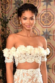 Chanel Iman, white lace dress with flowers. cute style, hair in braids